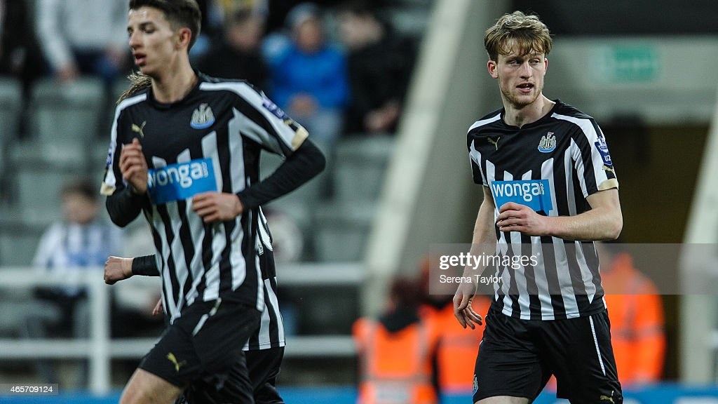 Tom Heardman of Newcastle (R) celebrates after scoring the equalising goal during the U21 Barclays Premier League match between Newcastle United and Stoke City at St. James' Park on March 9, 2015, in Newcastle upon Tyne, England, United Kingdom.