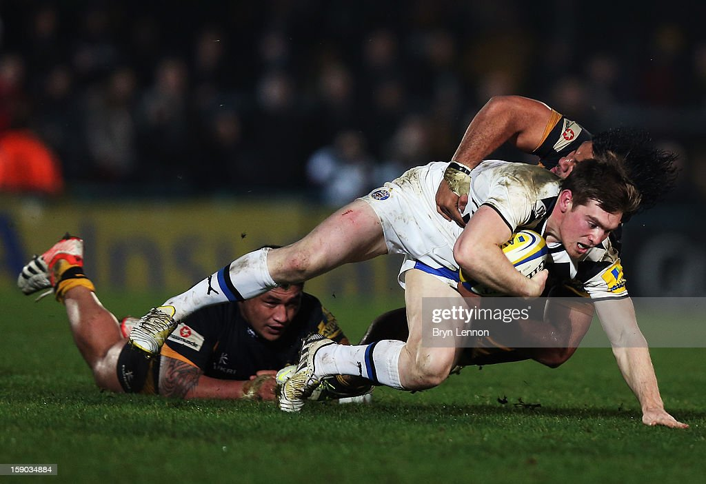 Tom Heathcote of Bath Rugby is tackled by Zak Taulafo of London Wasps during the Aviva Premiership match between London Wasps and Bath at Adams Park on January 6, 2013 in High Wycombe, England.