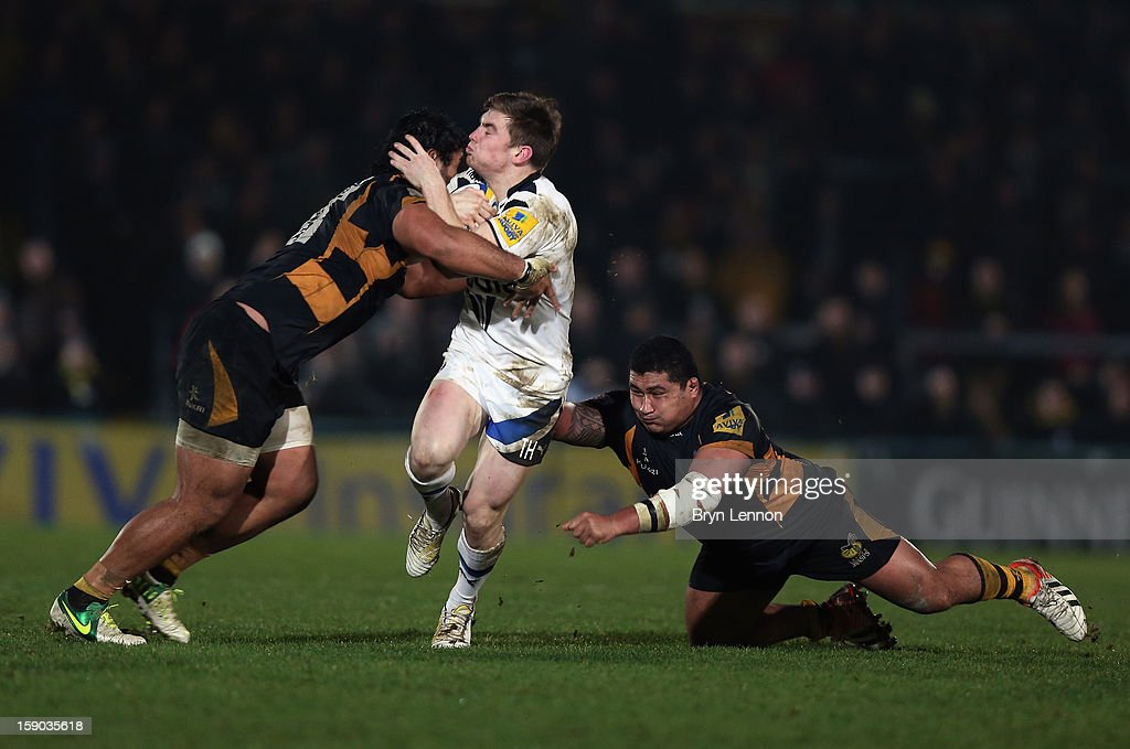 Tom Heathcote of Bath Rugby is tackled by Zak Taulafo (r) of London Wasps during the Aviva Premiership match between London Wasps and Bath at Adams Park on January 6, 2013 in High Wycombe, England.