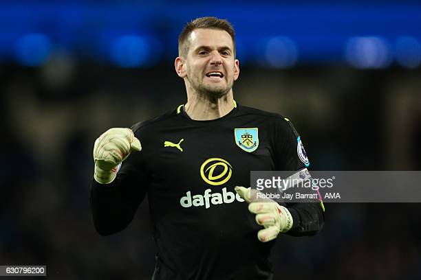 Tom Heaton of Burnley celebrates after Ben Mee of Burnley scores a goal to make it 21 during the Premier League match between Manchester City and...