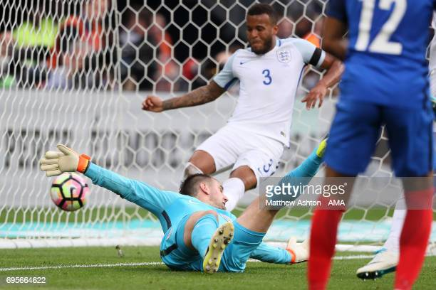 Tom Heaton of England is unable to stop Samuel Umtiti of France scoring a goal to make the score 11 during the International Friendly match between...