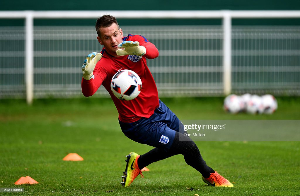 Tom Heaton of England makes a save during a training session ahead of the UEFA Euro 2016 match against Iceland at Stade du Bourgognes on June 26, 2016 in Chantilly, France.