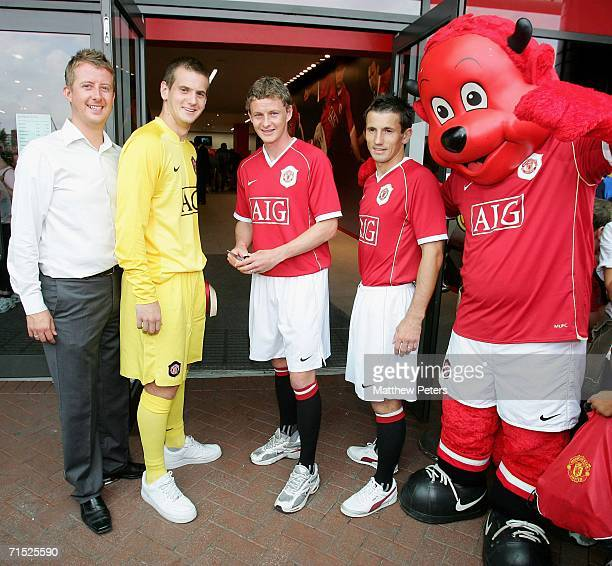 Tom Heaton Ole Gunnar Solskjaer and Liam Miller of Manchester United officially open the new Manchester United Megastore at the Official launch of...