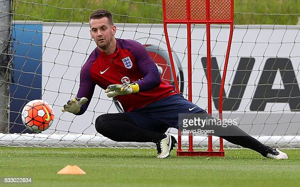 Tom Heaton saves during the England training session at St Georges Park on May 20 2016 in BurtonuponTrent England