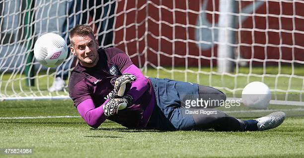 Tom Heaton saves during the England training session held at St Georges Park on June 4 2015 in BurtonuponTrent England