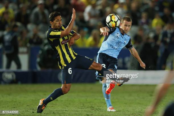 Tom Hiareiej of the Mariners contests the ball against Brandon O'Neill of Sydney FC during the round six ALeague match between the Central Coast...
