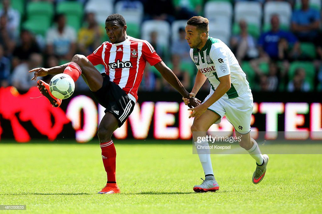 Tom Hiariej of Groningen challenges Cuco Martina of FC Southampton during the friendly match between FC Groningen and FC Southampton at Euroborg...