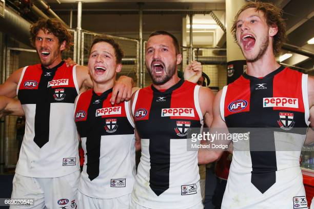Tom Hickey Jack Billings Jarryn Geary and Jimmy Webster of the Saints sing the club song after winning during the round four AFL match between the...