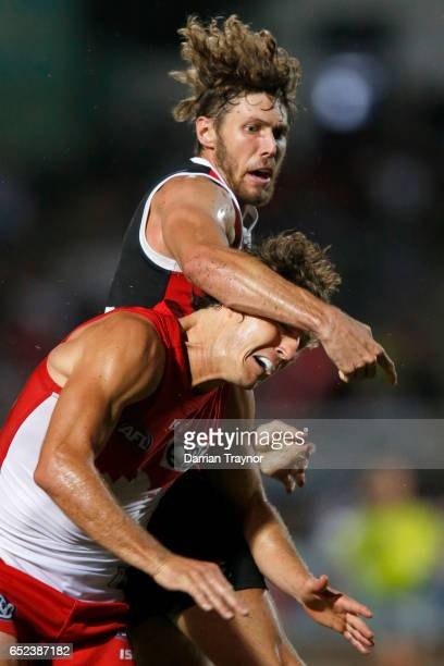 Tom Hickey of the Saints and Kurt Tippett of the Swans compeyte in the ruck during the JLT Community Series AFL match between the St Kilda Saints and...