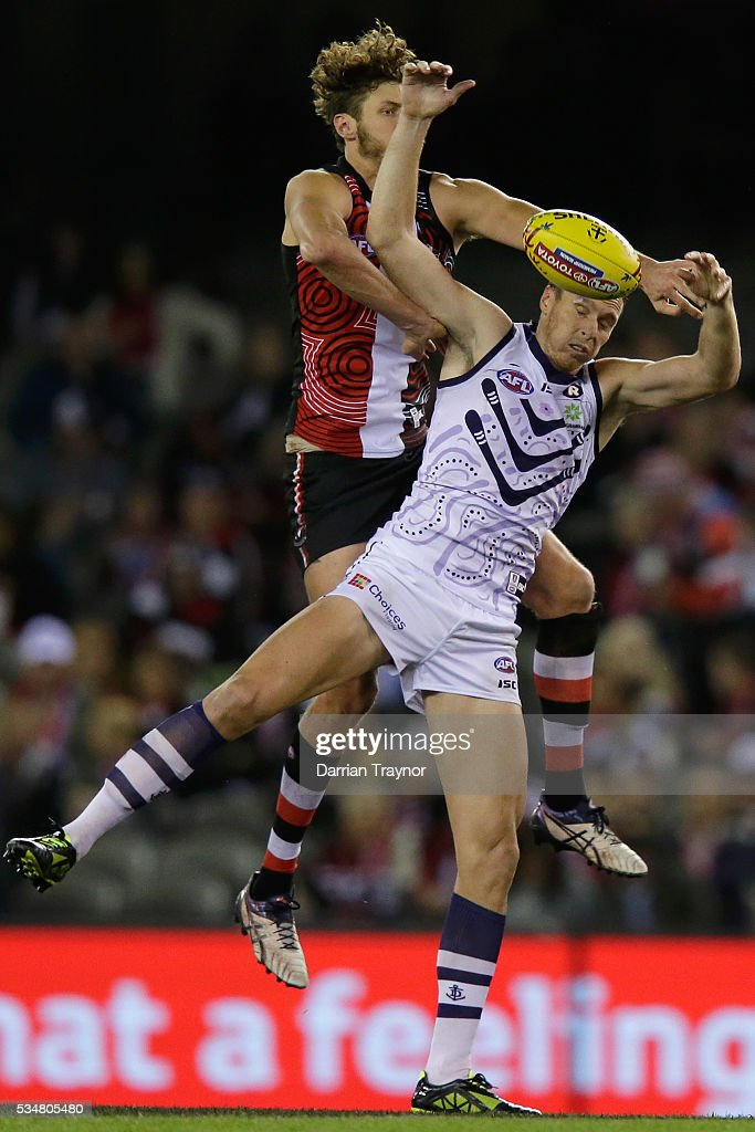 Tom Hickey of the Saints competes with Jonathon Griffin of the Dockers during the round 10 AFL match between the St Kilda Saints and the Fremantle Dockers at Etihad Stadium on May 28, 2016 in Melbourne, Australia.