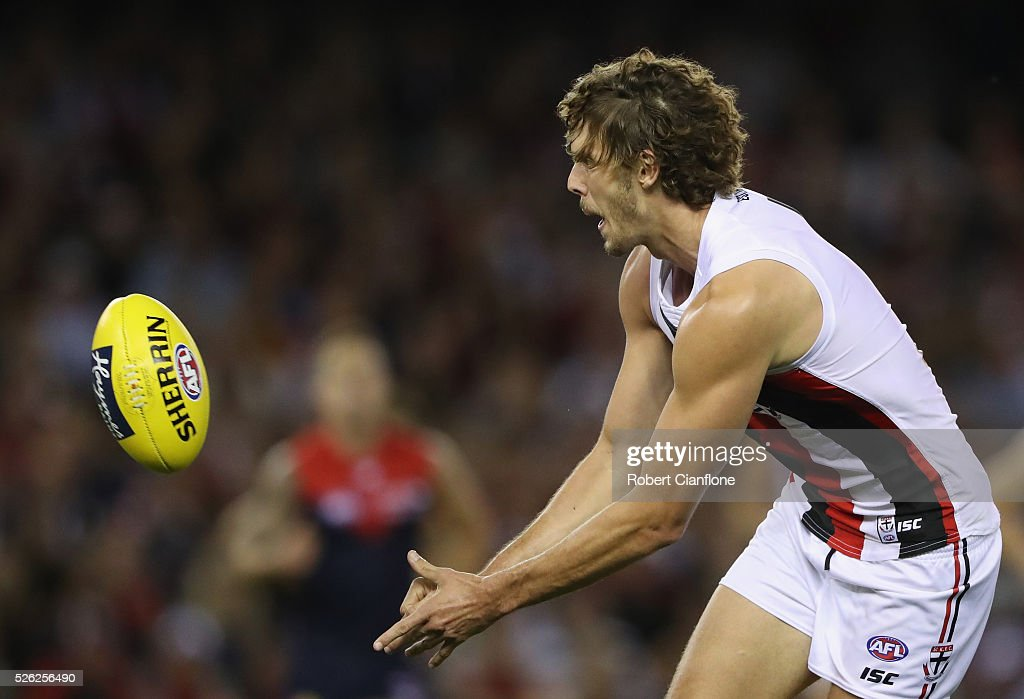 Tom Hickey of the Saints handballs during the round six AFL match between the Melbourne Demons and the St Kilda Saints at Etihad Stadium on April 30, 2016 in Melbourne, Australia.