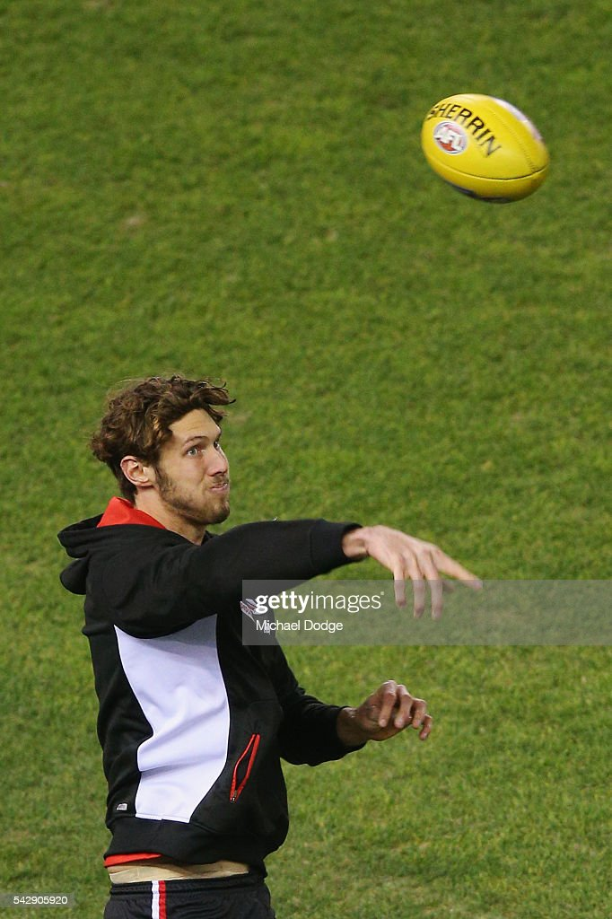 Tom Hickey of the Saints throws the ball during the round 14 AFL match between the St Kilda Saints and the Geelong Cats at Etihad Stadium on June 25, 2016 in Melbourne, Australia.