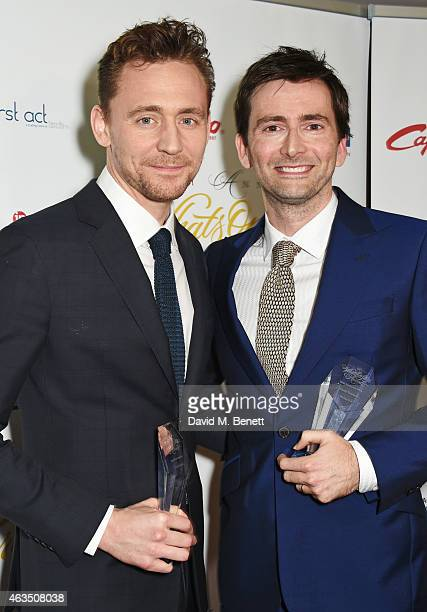 Tom Hiddleston accepting the award for Best Play Revival for 'Coriolanus' and David Tennant winner of Best Actor in a Play for 'Richard II' pose in...