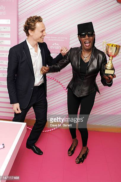Tom Hiddleston and Grace Jones attend the evian 'Live young' VIP Suite at Wimbledon on June 25 2012 in London England