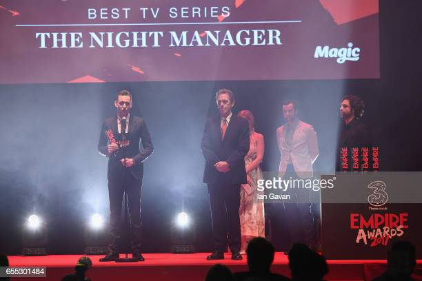 Tom Hiddleston and Hugh Laurie speak on stage with the award for Best TV Series to for The Night Manager during the THREE Empire awards at The...
