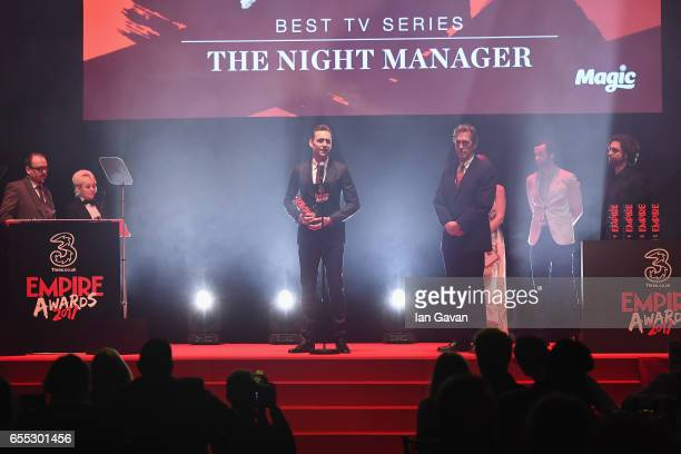 Tom Hiddleston and Hugh Laurie speaks on stage with the award for Best TV Series to for The Night Manager during the THREE Empire awards at The...