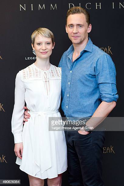 Tom Hiddleston and Mia Wasikowska attend the 'Crimson Peak' photocall at The Regent Hotel on September 30 2015 in Berlin Germany