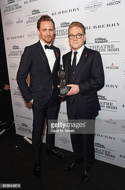 Tom HIddleston and Sir Kenneth Branagh winner of the Lebedev Award pose in front of the winners boards at The 62nd London Evening Standard Theatre...
