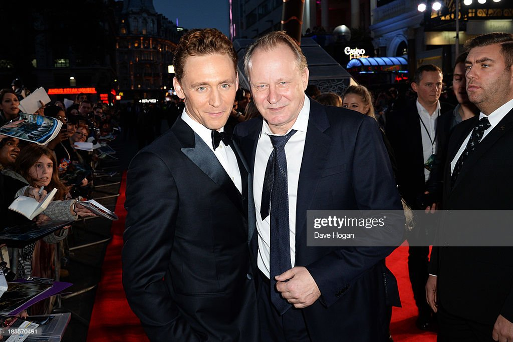 <a gi-track='captionPersonalityLinkClicked' href=/galleries/search?phrase=Tom+Hiddleston&family=editorial&specificpeople=4686407 ng-click='$event.stopPropagation()'>Tom Hiddleston</a> and <a gi-track='captionPersonalityLinkClicked' href=/galleries/search?phrase=Stellan+Skarsgard&family=editorial&specificpeople=233516 ng-click='$event.stopPropagation()'>Stellan Skarsgard</a> attend the world premiere of 'Thor: The Dark World' at The Odeon Leicester Square on October 22, 2013 in London, England.