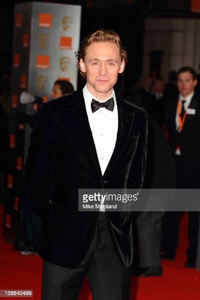 Tom Hiddleston arrives at the Orange British Academy Film Awards at The Royal Opera House on February 12 2012 in London England