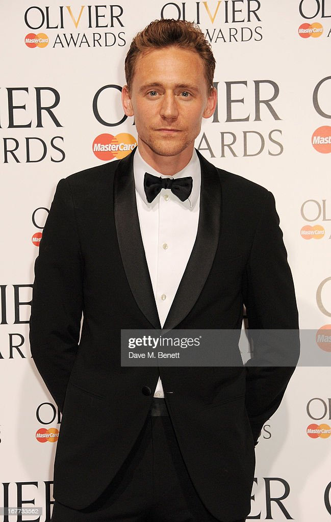 Tom Hiddleston poses in the press room at The Laurence Olivier Awards 2013 at The Royal Opera House on April 28, 2013 in London, England.