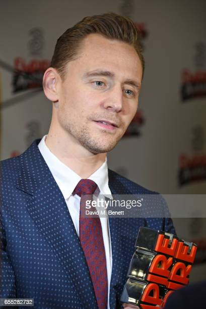 Tom Hiddleston poses in the winners room at the THREE Empire awards at The Roundhouse on March 19 2017 in London England