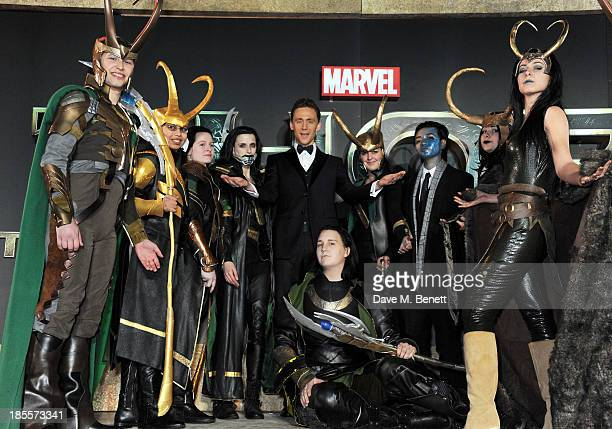 Tom Hiddleston poses with LookiLoki's at the World Premiere of 'Thor The Dark World' at Odeon Leicester Square on October 22 2013 in London England