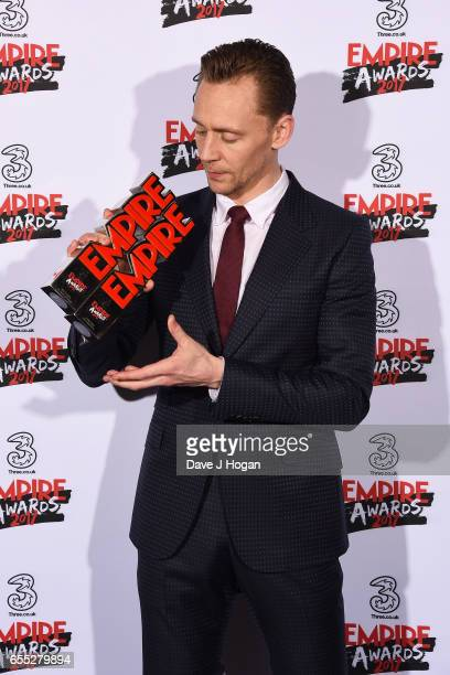 Tom Hiddleston poses with the awards for Empire Hero and Best TV Series The Night Manager in the winners room at the THREE Empire awards at The...
