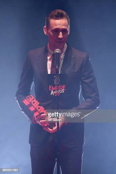 Tom Hiddleston speaks on stage with the award for Best TV Series to for The Night Manager during the THREE Empire awards at The Roundhouse on March...