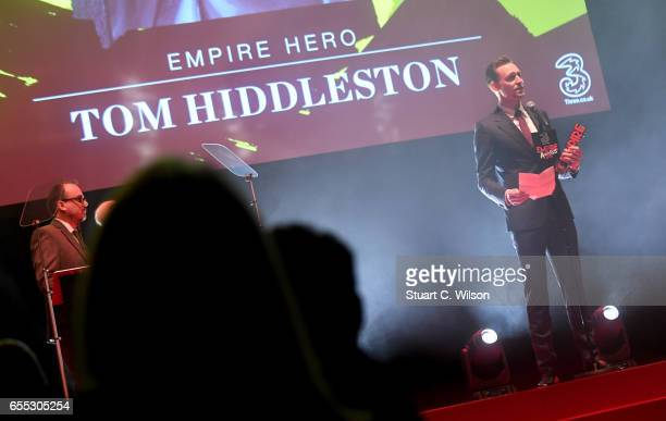 Tom Hiddleston wins the Empire Hero award during the THREE Empire awards at The Roundhouse on March 19 2017 in London England