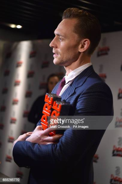 Tom Hiddleston with the Empire Hero Award and award for Best TV Series for The Night Manager n the winners room at the Three Empire Awards held at...