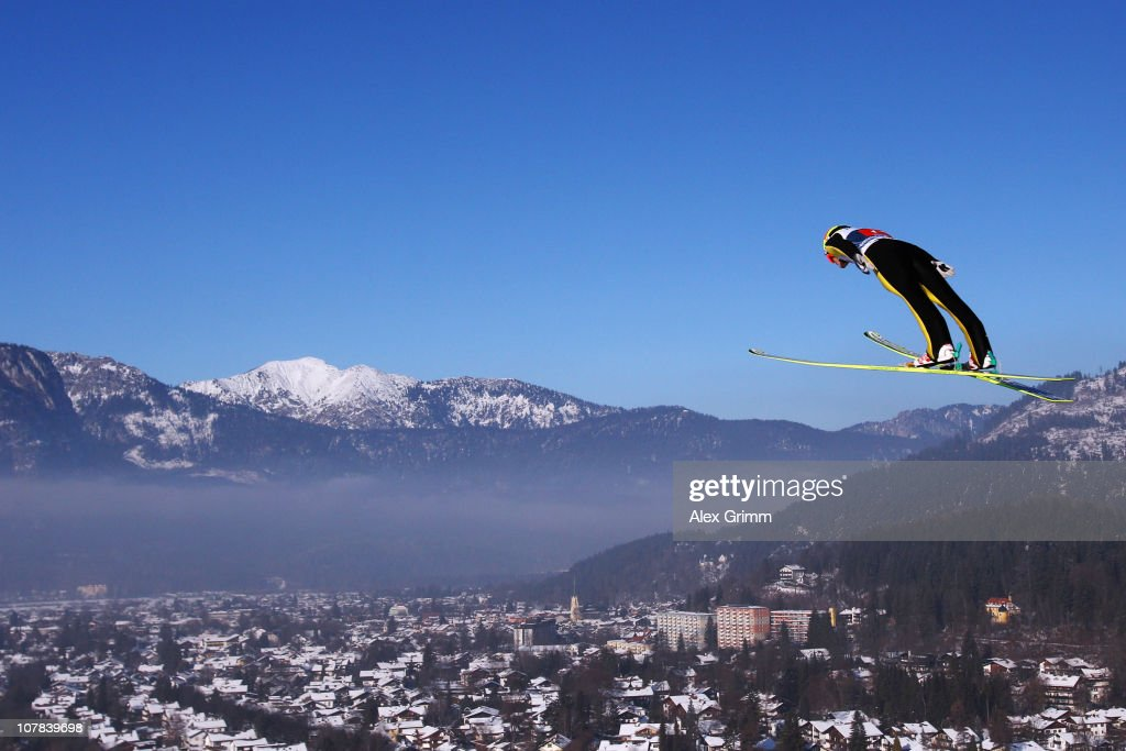 Tom Hilde of Austria competes during the trial round for the FIS Ski Jumping World Cup event at the 59th Four Hills ski jumping tournament at...