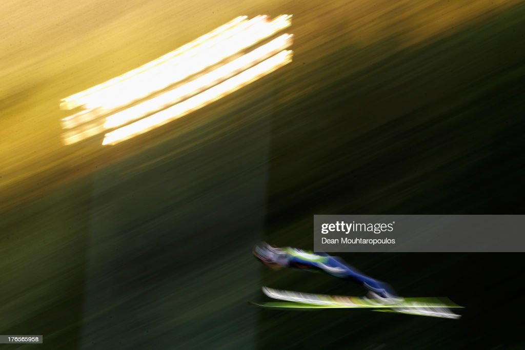 Tom Hilde of Norway competes in the 1st round in the FIS Ski Jumping Grand Prix Mens Large Hill Individual Final on August 15 2013 in Courchevel...