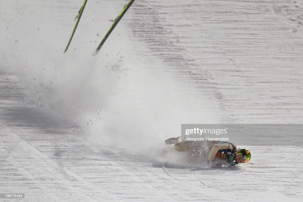 Tom Hilde of Norway crashes during the final round for the FIS Ski Jumping World Cup event of the 60th Four Hills ski jumping tournament at Erdinger...