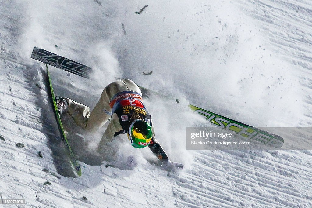 Tom Hilde of Norway crashes during the FIS Ski Jumping World Cup Vierschanzentournee on December 30 2011 in Oberstdorf Germany