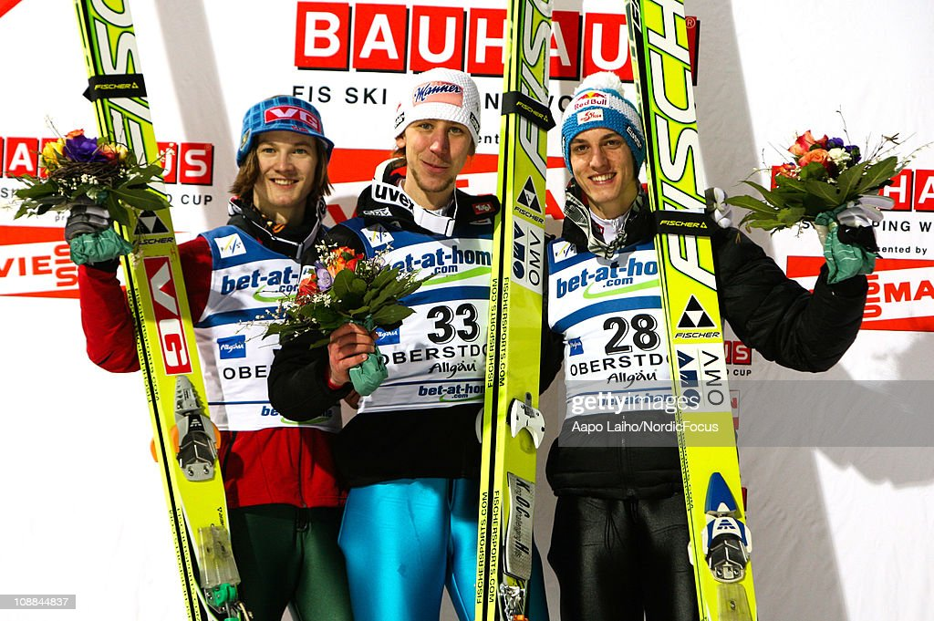Tom Hilde of Norway Martin Koch of Austria and Gregor Schlierenzauer of Austria pose on the podium after the individual HS213 during the FIS Ski...