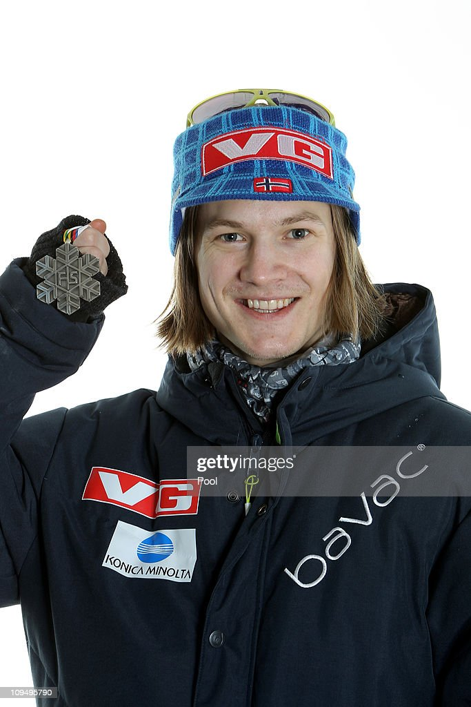 Tom Hilde of Norway poses with the the silver medal won in the Men's Ski Jumping Team HS106 competition during the FIS Nordic World Ski Championships...