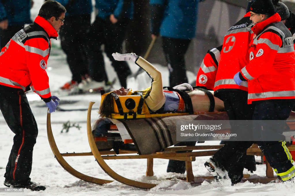Tom Hilde of Norway receives assistance after crashing during the FIS Ski Jumping World Cup Vierschanzentournee on December 30 2011 in Oberstdorf...