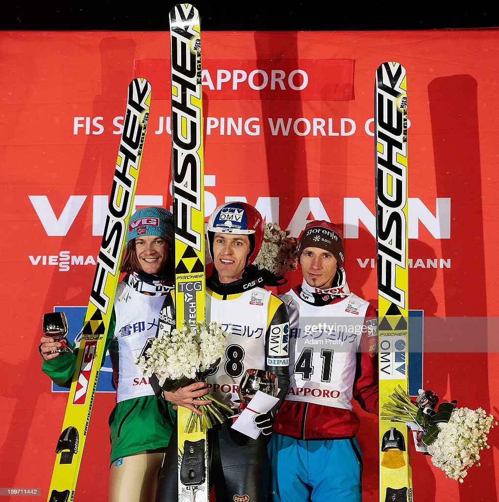Tom Hilde of Norway second place Jan Matura of the Czech Republic first place and Robert Kranjec of Slovenia third place pose for a picture on the...