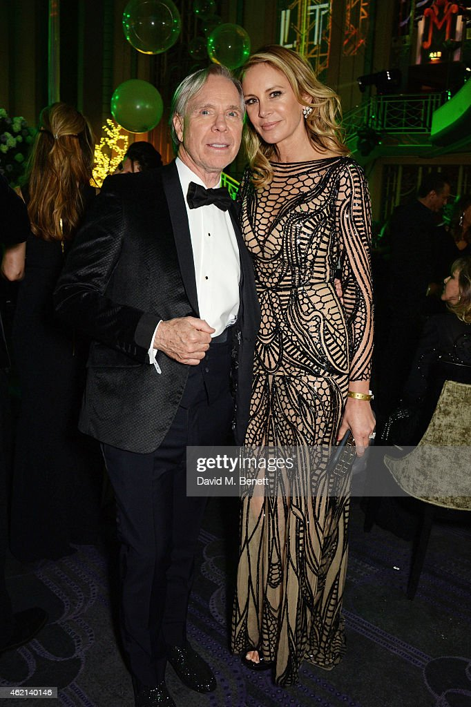 Tom Hilfiger and Dee Ocleppo attend Lisa Tchenguiz's 50th birthday party at the Troxy on January 24 2015 in London England