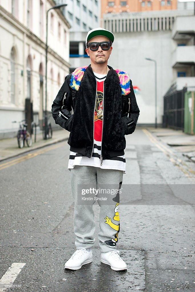 Tom Hirota fashion designer wearing a Christopher Shannon jacket, and Joey Rich trousers on day 3 of London Mens Fashion Week Autumn/Winter 2013, on January 09, 2013 in London, England.