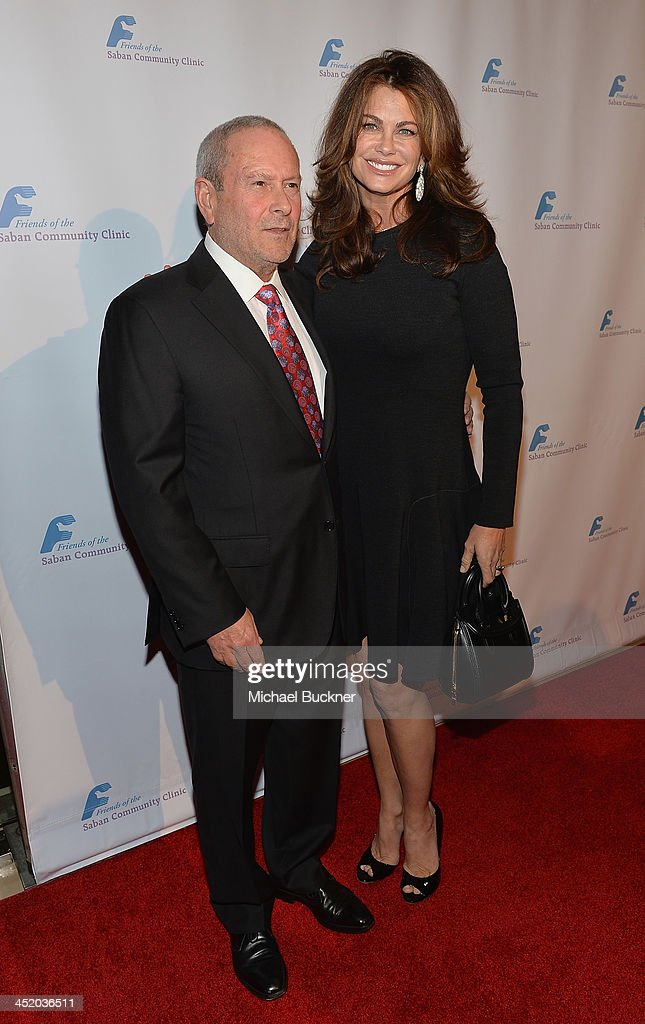 Tom Hoberman (L) and actress <a gi-track='captionPersonalityLinkClicked' href=/galleries/search?phrase=Kathy+Ireland&family=editorial&specificpeople=213018 ng-click='$event.stopPropagation()'>Kathy Ireland</a> arrives at the 37th Annual Saban Community Clinic Gala at The Beverly Hilton Hotel on November 25, 2013 in Beverly Hills, California.