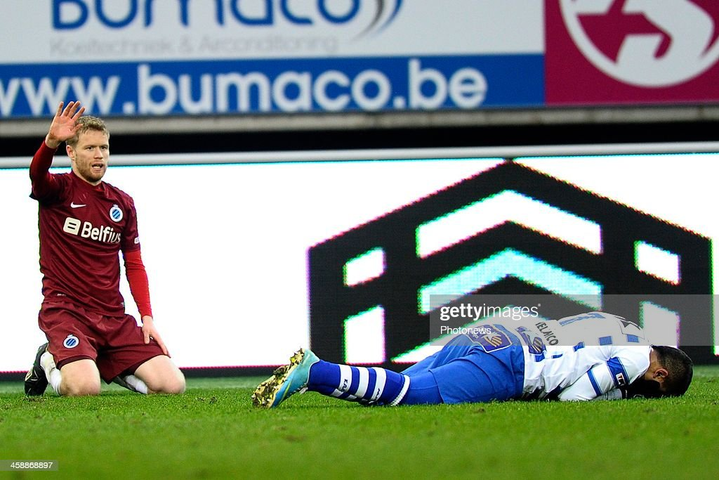 Tom Hogli of Club Brugge excusses for the foul on Yassine El Ghanassy of KAA Gent during the Jupiler League match between KAA Gent and Club Brugge on December 22, 2013 at the Ghelamco arena in Gent, Belgium.