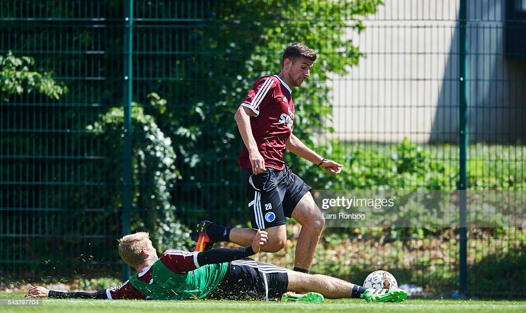 Tom Hogli of FC Copenhagen and Andrija Pavlovic (R) of FC Copenhagen compete for the ball during the FC Copenhagen training session at KB's baner on June 27, 2016 in Frederiksberg, Denmark.