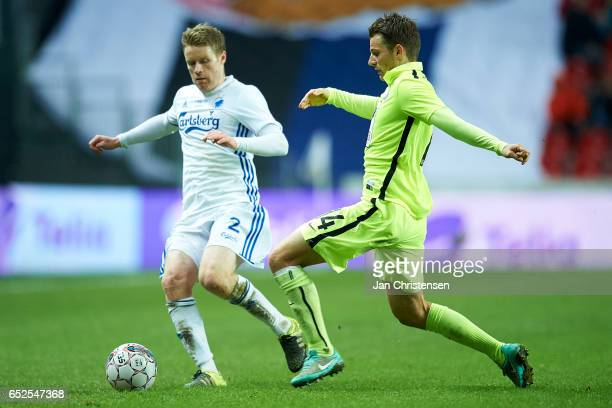 Tom Hogli of FC Copenhagen and Jesper Lauridsen of Esbjerg fB compete for the ball during the Danish Alka Superliga match between FC Copenhagen and...