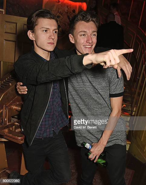 Tom Holland and Harrison Osterfield attend the Ibiza Rocks the Box Christmas Party at The Box Soho on December 8 2015 in London England