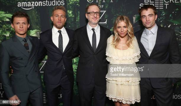 Tom Holland Charlie Hunnam Director James Gray Sienna Miller and Robert Pattinson attend the Amazon Studios and Bleeker Street's Los Angeles Premiere...
