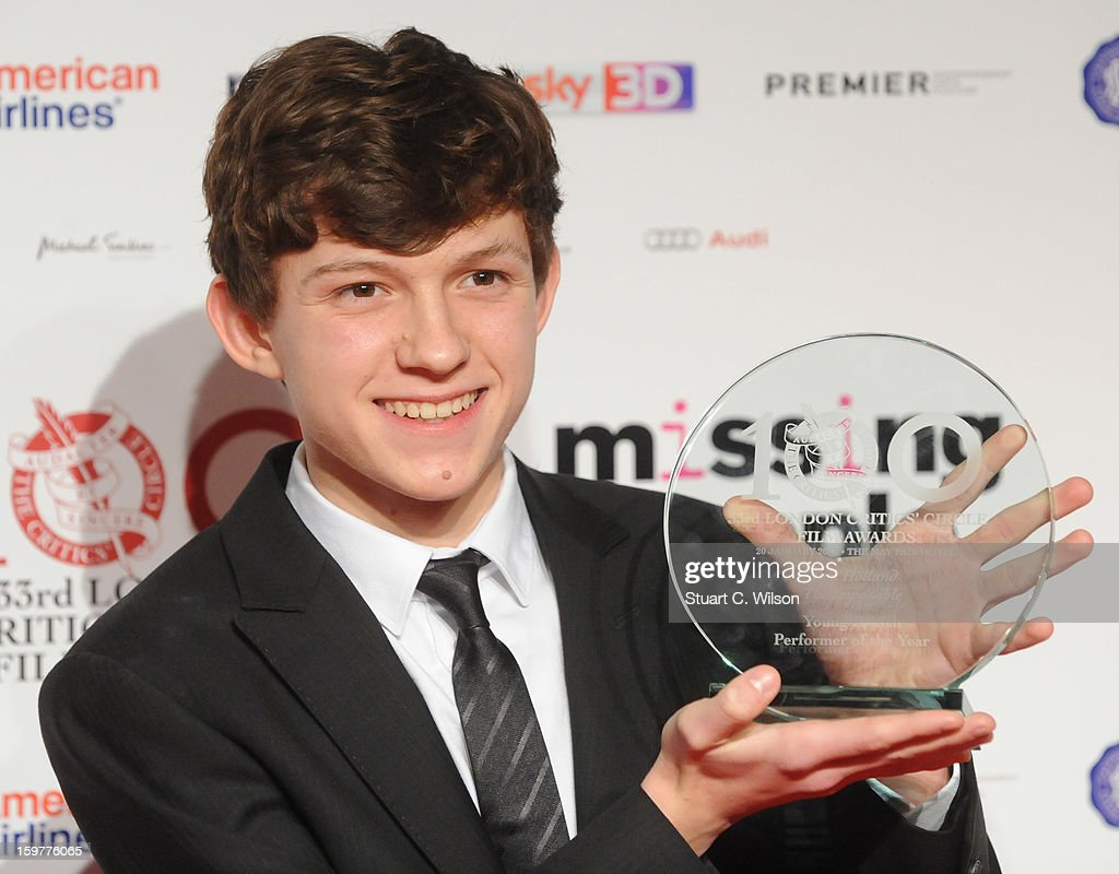 <a gi-track='captionPersonalityLinkClicked' href=/galleries/search?phrase=Tom+Holland+-+Actor&family=editorial&specificpeople=9843230 ng-click='$event.stopPropagation()'>Tom Holland</a> poses in the press room at the London Critics' Circle Film Awards at The Mayfair Hotel on January 20, 2013 in London, England.