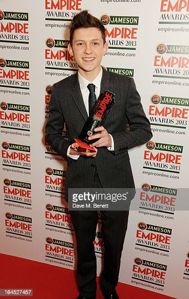 Tom Holland poses in the press room with the Best Male Newcomer award at the Jameson Empire Awards 2013 at The Grosvenor House Hotel on March 24 2013...