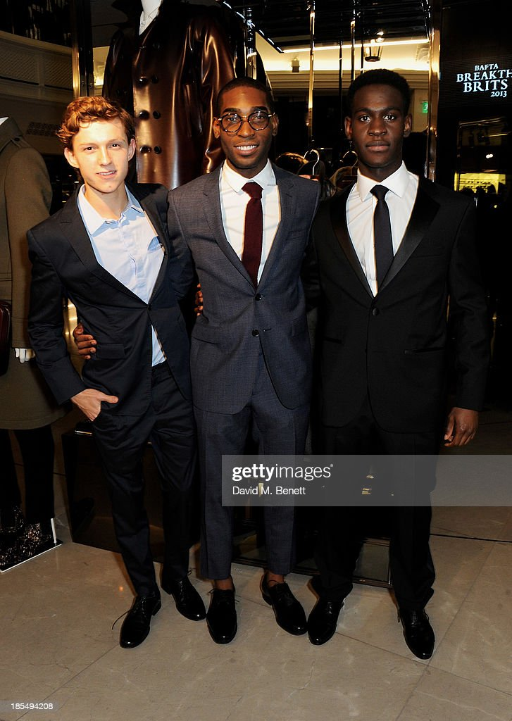 Tom Holland, Tinie Tempah and Ade Oyefeso attend the BAFTA 'Breakthrough Brits' event at Burberry 121 Regent Street, London on October 21, 2013 in London, United Kingdom.